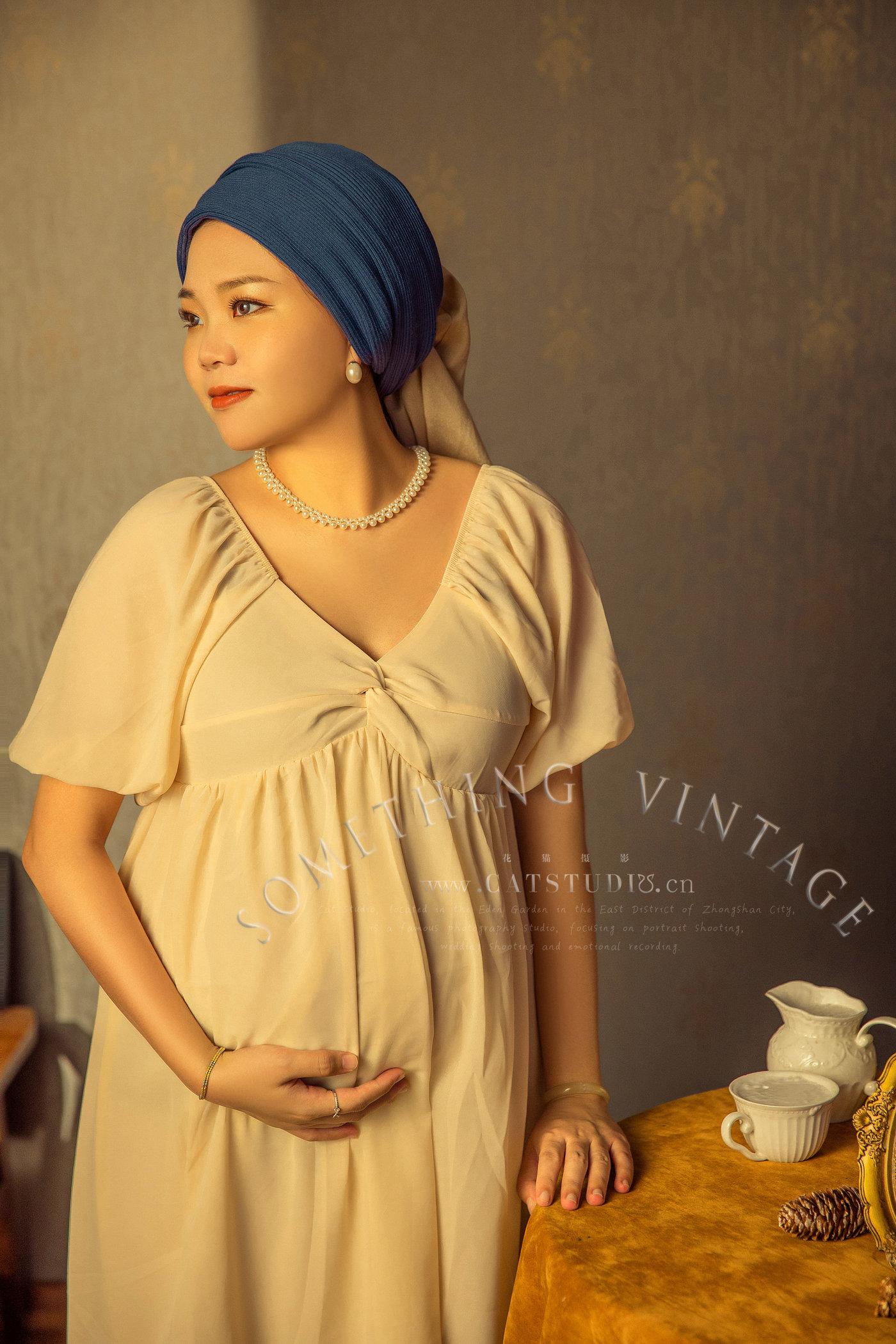 带珍珠耳环的少女-(孕照)1