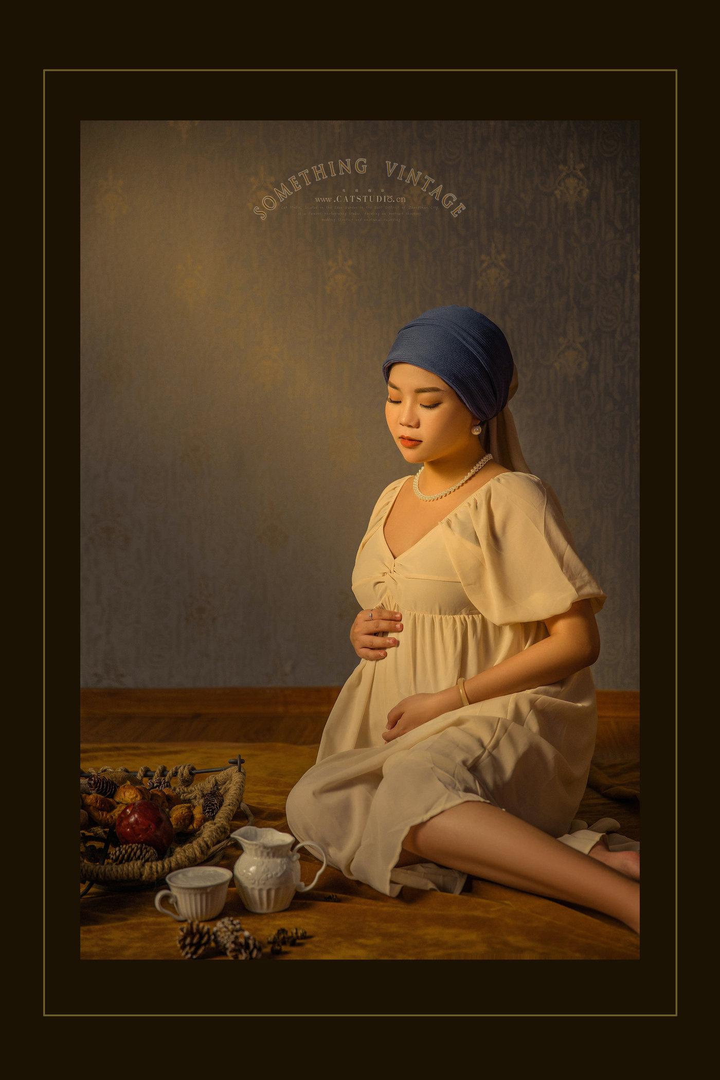 带珍珠耳环的少女-(孕照)6
