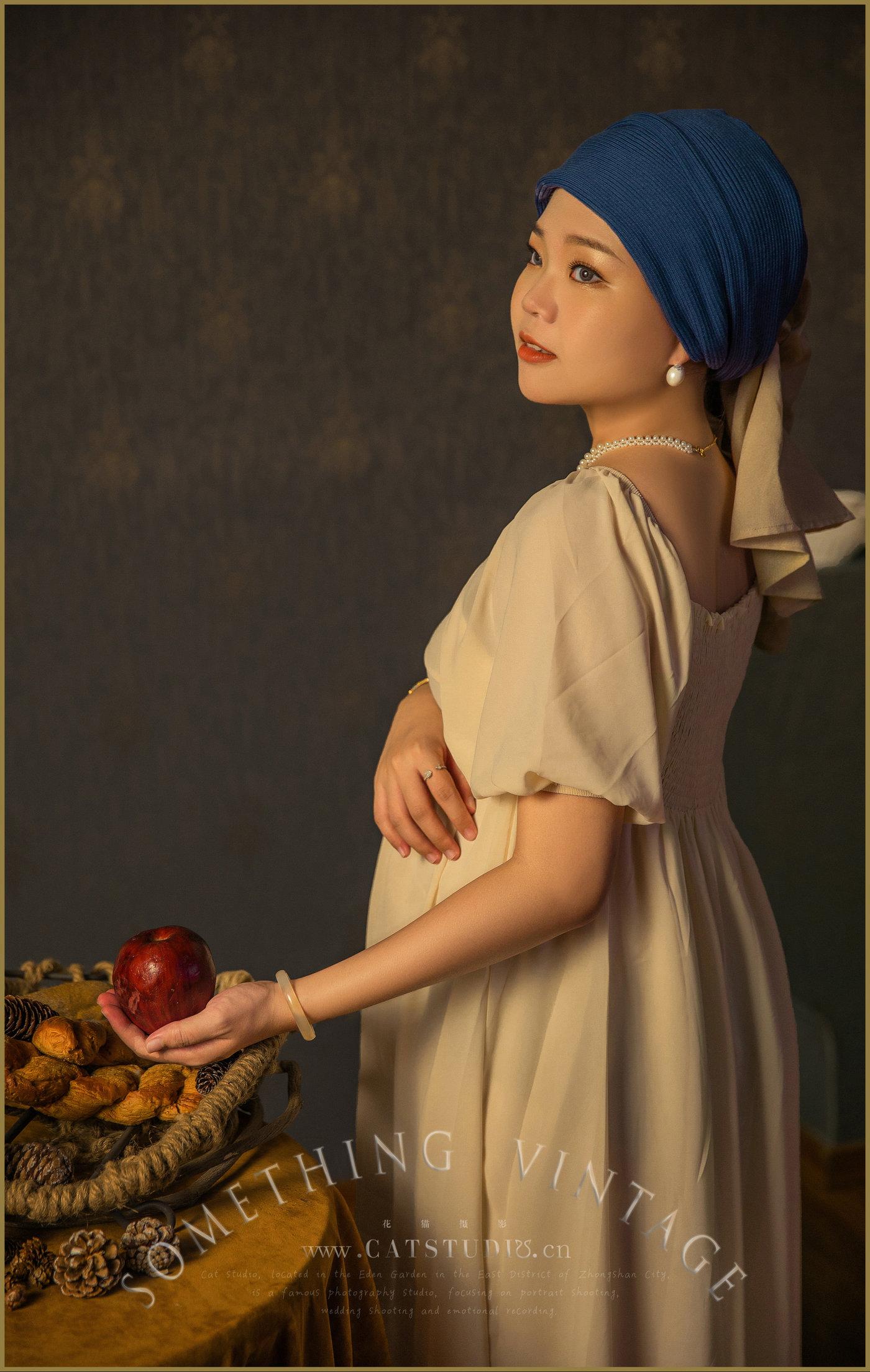 带珍珠耳环的少女-(孕照)4