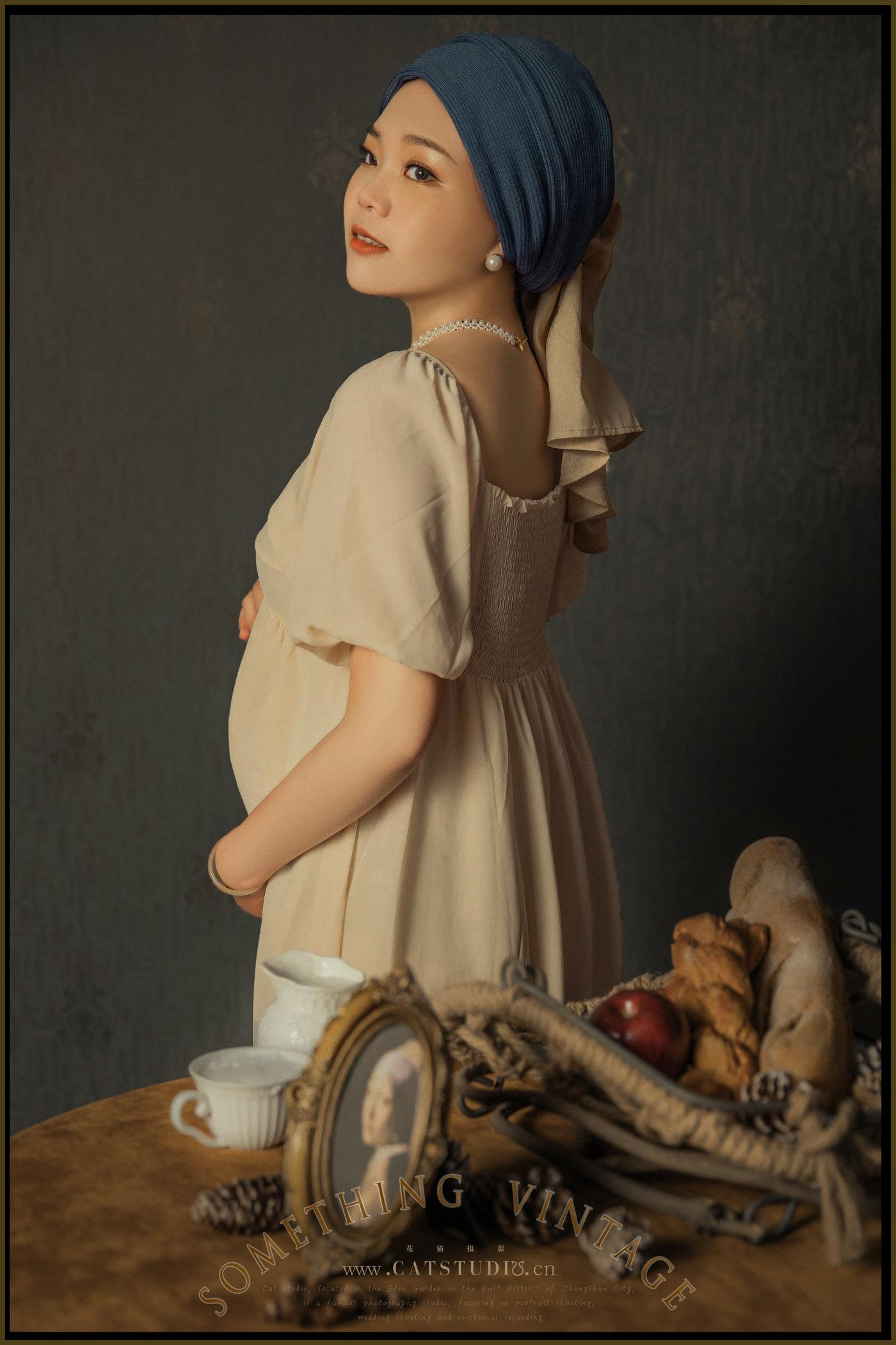 带珍珠耳环的少女-(孕照)8